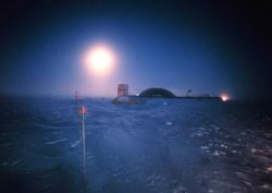 Moon? Seems to be time exposure of moon with South Pole Station illuminated. Photo