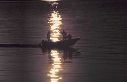 Skiff returning at sunset from marine mammal studies. Photo