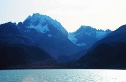 Rugged Alaska shoreline and mountains Photo