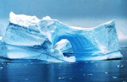 Arches in icebergs off the Antarctic Peninsula Photo