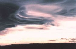 Mountain wave clouds over Tierra Del Fuego Photo