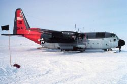 Ski-equipped C-130 on the ground at South Pole Station. Photo