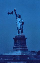 The Statue of Liberty, New York Harbor, with Navy helicopter during 1976 Bicentennial Tall Ship celebration Photo