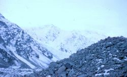 A dry valley surrounded by Antarctic mountains Photo