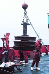 Deploying the trainwheel anchor for a mooring in the Ross Sea. Photo