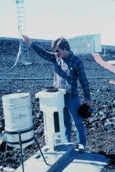 John Bortniak taking rainfall readings at the Mauna Loa Observatory. Photo