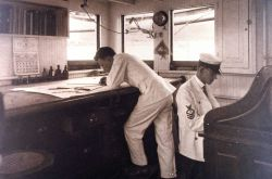 Working on a hydrographic survey smooth sheet on board the C&GS Ship BACHE in July 1916. Photo