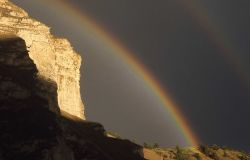 Rainbow above cliffs in Gardner Canyon Photo