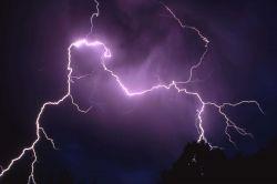 Lightening storm over Mt Everts Photo