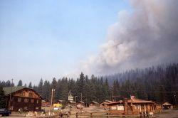 Smoke plume rising behind Silvergate, Montana Photo