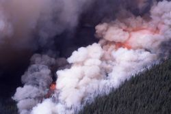 Aerial view of Crown fire with dense smoke on Mirror Plateau Photo