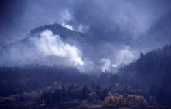 Smoldering fire with yellow aspen trees in burned meadow (possibly Elk Creek) - Smoke Photo