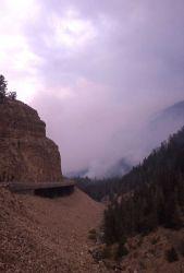 View north thru Golden Gate toward smoldering slopes & smoke of Bunsen Peak Photo