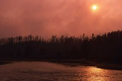 Smokey sunset along Madison River Photo
