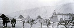 Six-horse stagecoach with Mt Everts in the background Photo