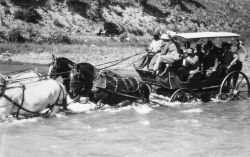 Stage coach going through Lamar River Photo