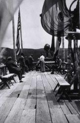 Visitors on top of Old Faithful Inn Photo