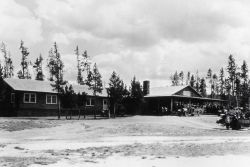 People and buses at Old Faithful Lodge Photo