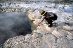 Ranger at edge of Great Fountain Geyser Photo