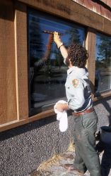 Maintenance worker washing windows at Old Faithful Visitor Center Photo