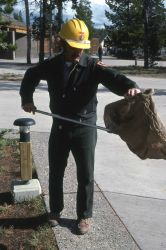 Maintenance worker picking up litter Photo