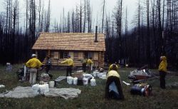 Maintenance workers gathering their supplies for departure from the Sportsman Lake cabin Photo