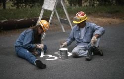 Youth Conservation Corp workers painting parking numers in campground Photo