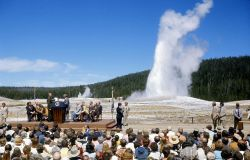 Old Faithful erupting behind President Gerald Ford Photo