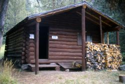 Crystal Springs patrol cabin (moved to the Three Rivers area in the Bechler region in the early 1990's) Photo