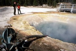 Siphon being used to clean Morning Glory Pool Photo