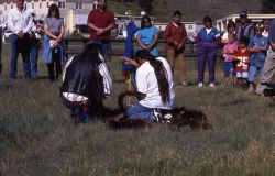 Rocky Afraid of Hawk with son, singing & blessing pipe at bison ceremony Photo