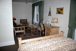 Renovated room & furnishings in the east wing of Old Faithful Inn Photo