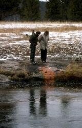 Rick Hutchinson (NPS) & Bob Fournier (USGS) inspecting test holes for new bridge near Ojo Caliente Photo