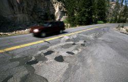 Filled potholes on road above Gibbon Falls Photo