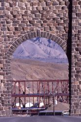 Construction of the Heritage Center as seen through the Roosevelt Arch (which is located at the north entrance to Yellowstone National Park) Photo