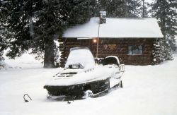 Snowmobile at West Thumb warming hut Photo