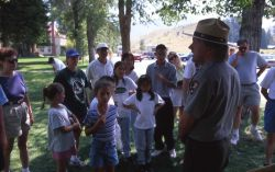 Ranger Bill Halverson leading a ranger talk in front of the Albright Visitor Center at Mammoth Hot Springs Photo