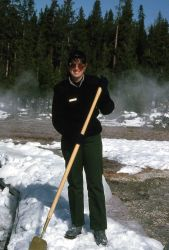 Interpretive Ranger Holly McKinney chopping ice off of the boardwalk at Old Faithful Photo