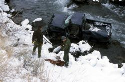 Rangers Keith Young & Jeff Hereford at the site of a motor vehicle accident in the Gardner River/Gardner River Canyon Photo