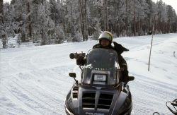 Ranger Bob Love using radar gun to time snowmobiler Photo