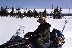 Ranger Bob Love on a snowmobile at Canyon Village Photo