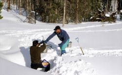 Ranger Brian Chan & Dave Long collecting water from spring at Upper Miller Creek cabin Photo