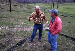 Don Despain with reporter at the Arrow fire site Photo