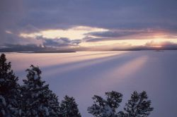 Sunset in winter over Yellowstone Lake Photo