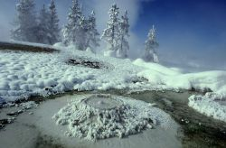 West Thumb Mud Pot surrounded by snow Photo