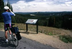 Cyclist at Washburn Hot Springs overlook Photo