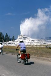 Cycling past Castle Geyser Photo