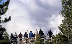 Visitors watching steam phase of Steamboat Geyser from May 2, 2000 eruption Photo