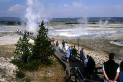 Visitors on the boardwalk in Lower Geyser Basin Photo