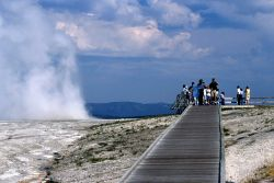 Visitors on boardwalk in Lower Geyser Basin Photo